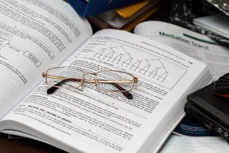 Business Textbook and Glasses