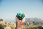 Top 5 Things To Take When Studying Abroad Article - Globe in Hand PIcture