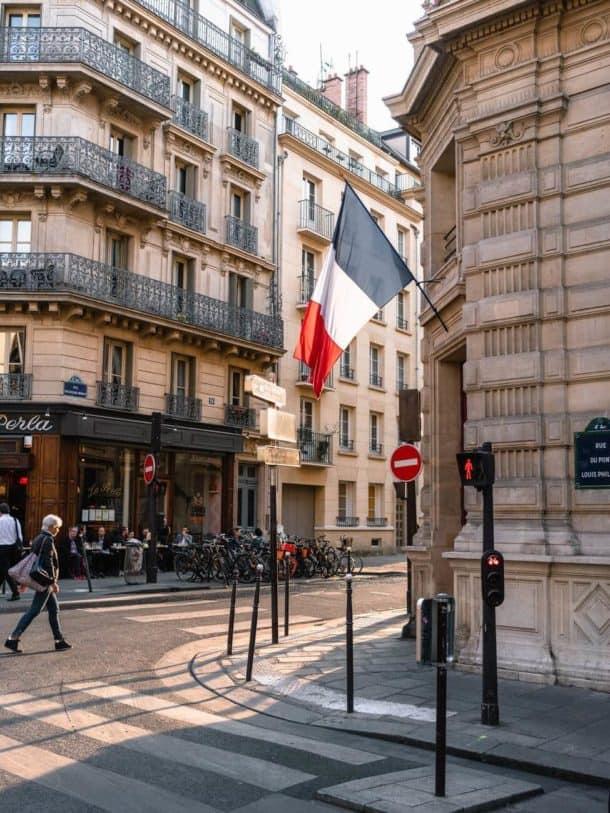 french flag on a parisian street corner