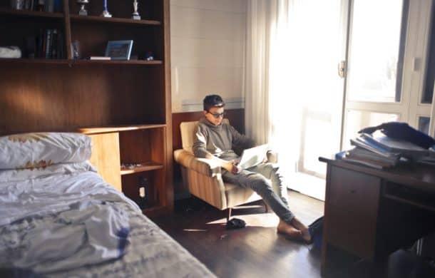 man sat in university accommodation room